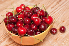 Ripe cherries in a yellow bowl Royalty Free Stock Photography