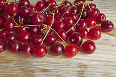Ripe cherry on a board. Much ripe cherry on a board Royalty Free Stock Images