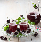 Ripe cherry and cherry juice Royalty Free Stock Photo