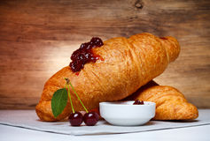 Ripe cherry with croissant Stock Photos