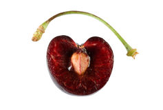 Ripe cherry cut in halves Royalty Free Stock Images