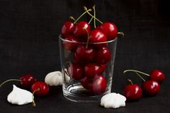 Ripe cherry in a glass on a black background stock images