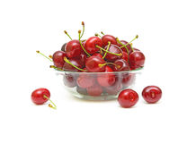 Ripe cherry in a glass bowl on a white background. Ripe cherry in a glass bowl isolated on a white background Royalty Free Stock Photos