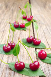 Ripe cherry and green leaf Royalty Free Stock Photo