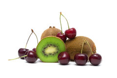 Ripe cherry and juicy kiwi closeup on a white background Royalty Free Stock Images