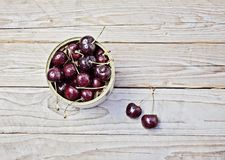 Ripe cherry in a metalic jar on wooden table. Ripe cherry in metallic jar on wooden table Summer and harvest concept Organic garden healthy concept Stock Image