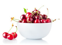 Ripe cherry in plate with green leaf Stock Photography