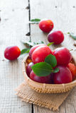 Ripe cherry-plums in the basket Royalty Free Stock Image