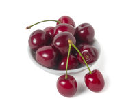 Ripe cherry on a saucer Stock Images