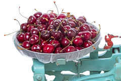Ripe cherry on the scales Stock Photos