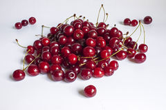 Ripe cherry is with sprigs. Much ripe cherry is with sprigs Stock Image
