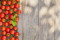 Ripe cherry tomatoes and basil Stock Photo