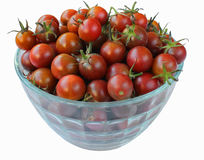 Ripe cherry tomatoes in glass bowl isolated on white. Background Royalty Free Stock Photos