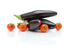 Cherry tomatoes and eggplant on a white background close-up Stock Images