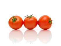 Ripe cherry tomatoes on a white background Royalty Free Stock Images
