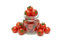 Ripe cherry tomatoes on a white background Stock Images