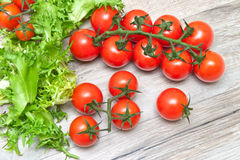 Ripe cherry tomatoes on a wooden background Royalty Free Stock Photos