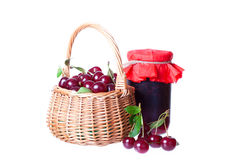 Ripe cherry in a wattled basket Stock Photos