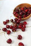 Ripe cherry in a wooden bowl Royalty Free Stock Photos