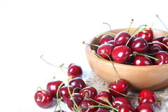 Ripe cherry in a wooden bowl Stock Photography