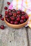 Ripe cherry in a wooden bowl Stock Image