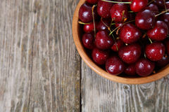 Ripe cherry in a wooden bowl Stock Photos