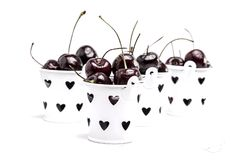 Ripe Cherrys in small white buckets Royalty Free Stock Photo