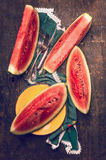 Ripe chopped watermelon on rustic kitchen table Stock Image