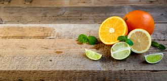 Ripe Citrus Fruit on the Old Wooden Table. Orange, Lime, Lemon Mint. Healthy Food. Summer Background. Stock Photos