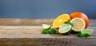 Ripe Citrus Fruit on the Old Wooden Table. Orange, Lime, Lemon Mint. Healthy Food. Summer Background. Royalty Free Stock Photo