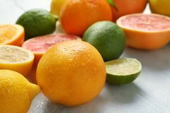 Ripe citrus fruits on table royalty free stock image