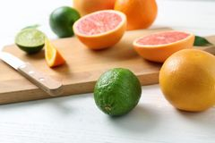 Ripe citrus fruits on table royalty free stock photos