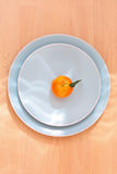 Ripe clementines on the blue, pastel plate Royalty Free Stock Images