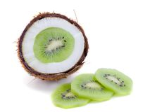 Ripe coconut fruit and sliced kiwi. On a white background. Exotic fruits Royalty Free Stock Photo