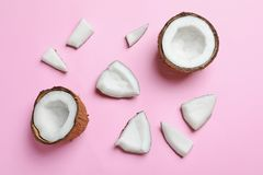 Ripe coconuts on color background. Top view Stock Photo