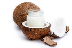 Ripe coconuts and organic coconut oil in glass jar Royalty Free Stock Photography