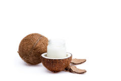 Ripe coconuts and organic coconut oil in glass jar Stock Images