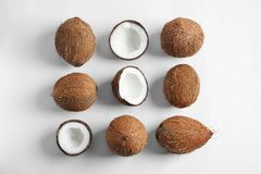 Ripe coconuts on white background,. Flat lay Royalty Free Stock Photography