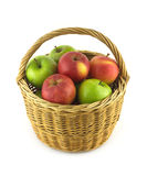 Ripe color apples in brown wicker basket isolated Stock Images