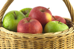 Ripe color apples in brown wicker basket isolated Royalty Free Stock Image