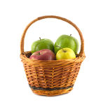 Ripe color apples in brown wicker basket isolated Royalty Free Stock Photo