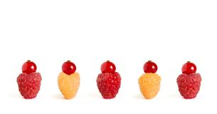 Ripe Colorful Raspberries with Red Currants on the Top  on the White Background. Row of Ripe Colorful Raspberries with Red Currants on the Top  on the White Stock Photography