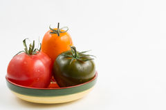 Ripe colorful red, yellow and green kumato tomatoes in wet kitch Stock Image