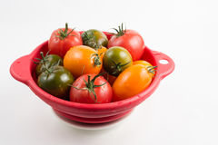 Ripe colorful red, yellow and green kumato tomatoes in wet kitch Stock Photos