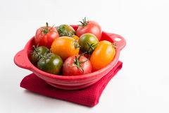 Ripe colorful red, yellow and green kumato tomatoes in wet kitch Royalty Free Stock Photography
