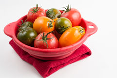 Ripe colorful red, yellow and green kumato tomatoes in wet kitch Royalty Free Stock Images