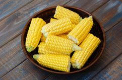 Ripe corn in a clay bowl. royalty free stock photos