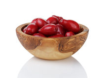 Ripe cornel berries in wood bowl Royalty Free Stock Photos