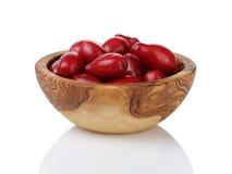 Ripe cornel berries in wood bowl Royalty Free Stock Photos
