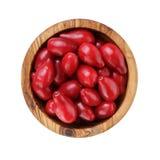 Ripe cornel berries in wood bowl Stock Images